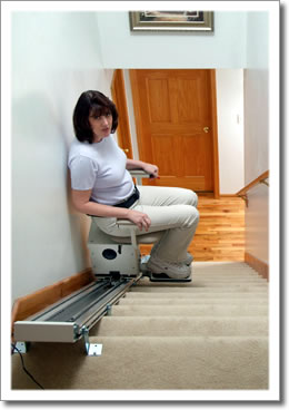 Lady in stair lift
